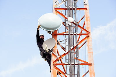 Ben Leslie of Columbia Wireless performs work on a tower overlooking Nelson. Photo credit: Colin Payne